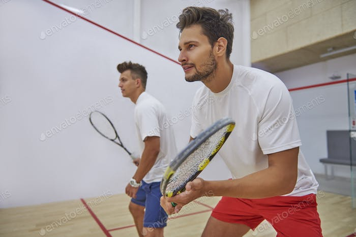 Very pensive men on the squash court