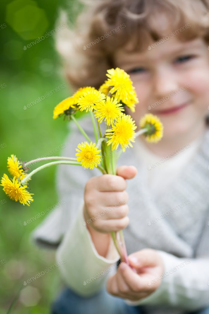 Child with bunch of dandelion