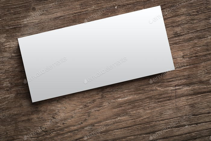 Blank corporate identity on wood background.