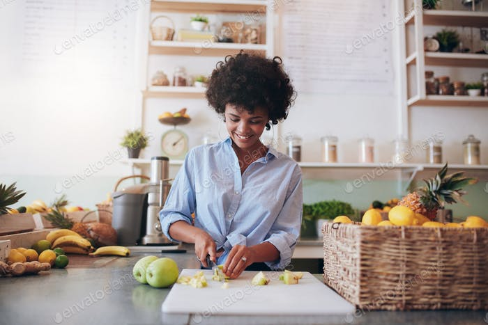Young woman making fresh juice