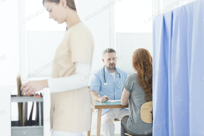 Gynecologist during consultation in office