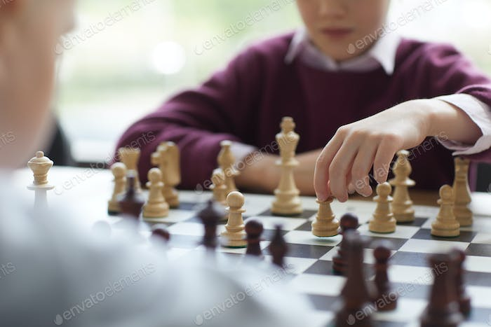 Girl putting chess piece