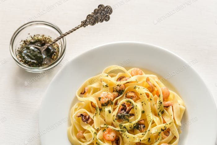 Tagliatelle pasta with mint sauce and seafood