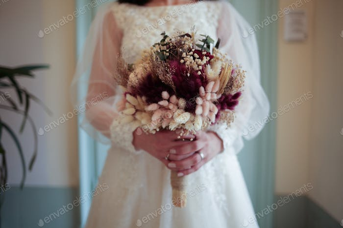 The bride is holding her flowers