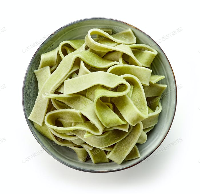 bowl of egg noodles with spinach