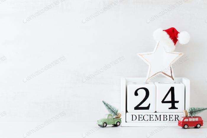 Christmas backgrounds. Christmas calendar, 24 december on the gray background.