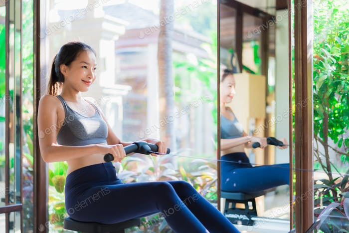 Portrait beautiful young asian woman exercise with fitness equip