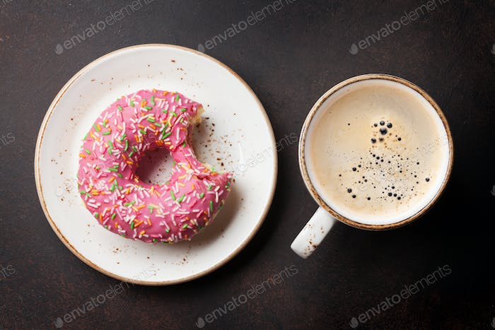 Coffee cup and donut