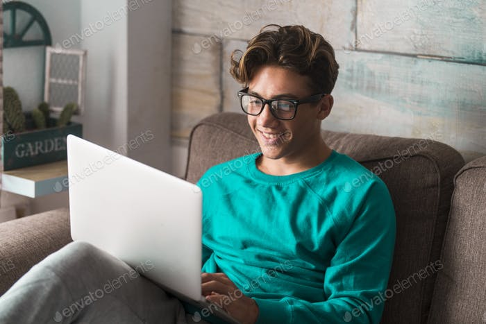 Young caucasian student study at home with internet