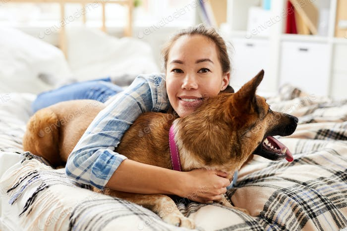 Asian Woman Hugging Dog