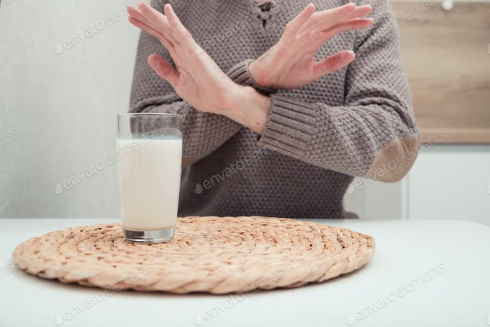 Man feels bad, lactose intolerance. Dairy intolerant person. Health care concept and milk
