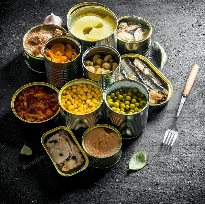 Open cans of mushrooms, pineapples, corn and canned fish.