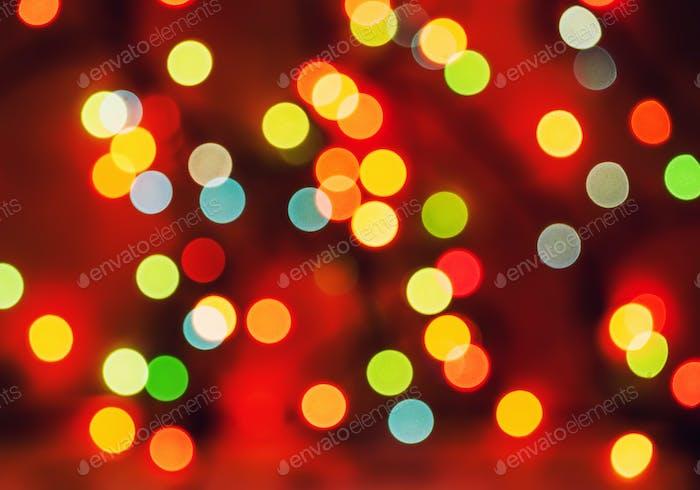 Multicolored defocused bokeh blurry lights, Christmas lights, festive background