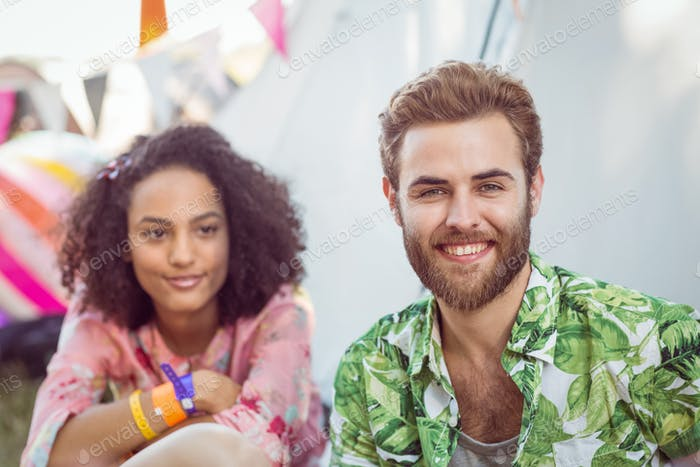 Happy hipsters smiling at camera at a music festival