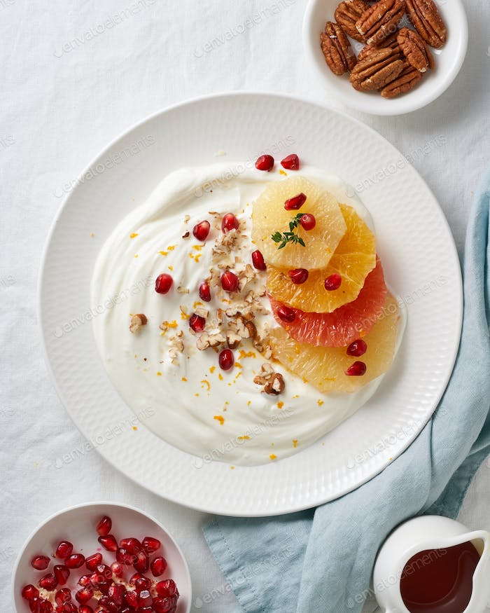 Ricotta with citrus fruits, pecans. Mixed salad with coconut yoghurt. Sweet colorful dessert