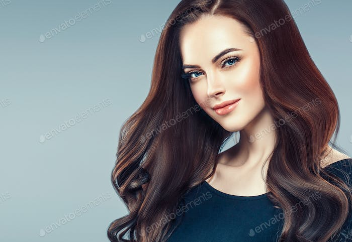 Thumbnail for Brunette curly hair. Beautiful woman with long beauty healthy hair portrait