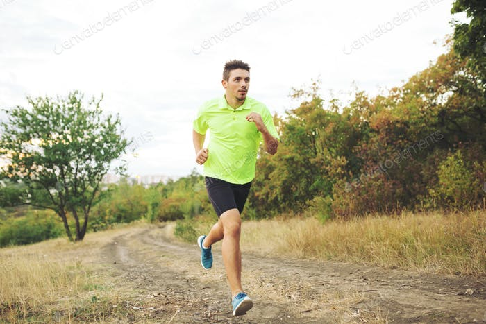 Athletic man running in the park