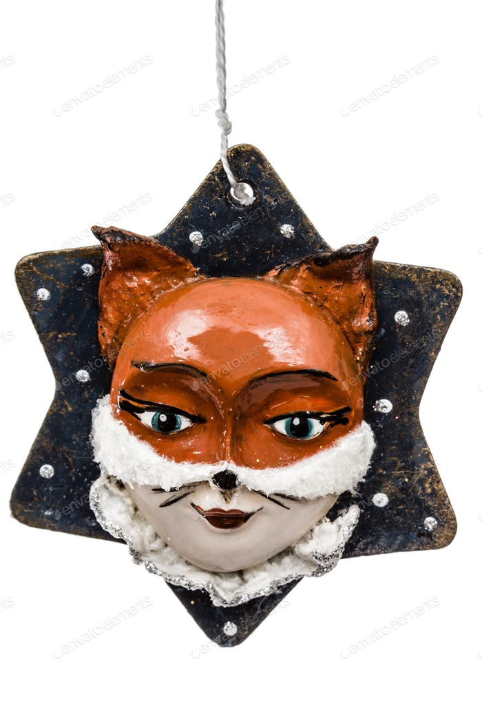 Festive decoration in the shape of a foxy mask, isolated on whit