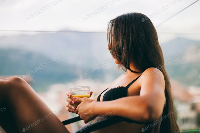 Woman with smartphone drink juice