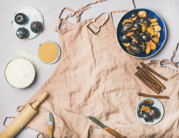 Baking ingredients and tools over pastel background, copy space