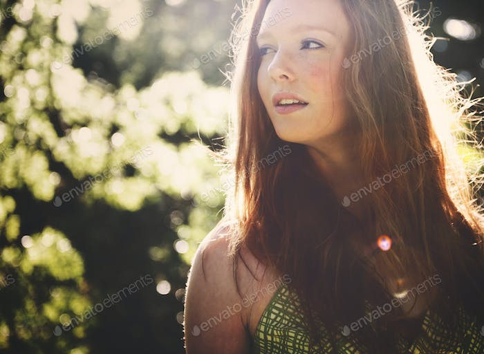 Beautiful young woman in the nature