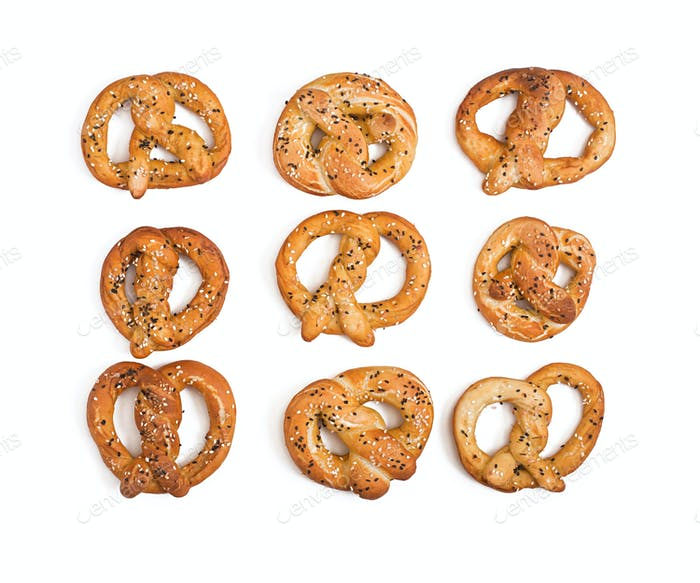 Pretzels with salt and sesame seeds isolated on white background. Top view. Oktoberfest.
