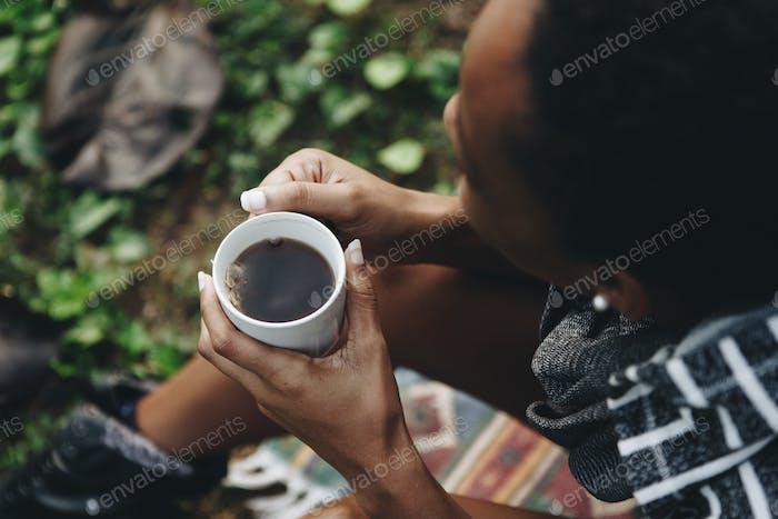 Woman enjoying her morning coffee in nature