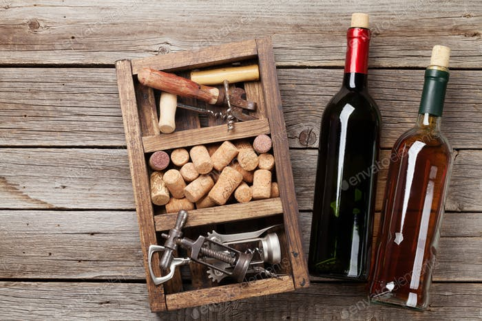 Wine bottles, corkscrew and corks
