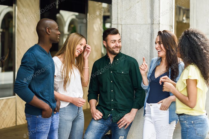 Multi-ethnic group of friends having fun together in urban background