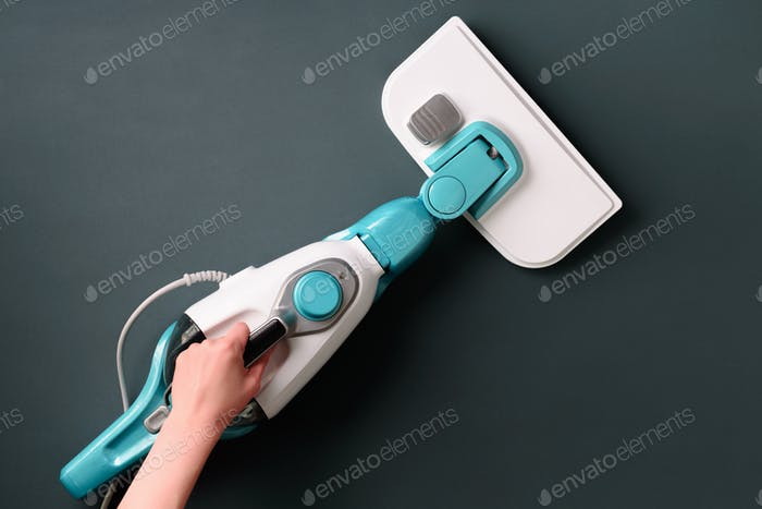 Steam cleaner mop on grey background. Top view, flat lay. Banner with copy space. Cleaning service
