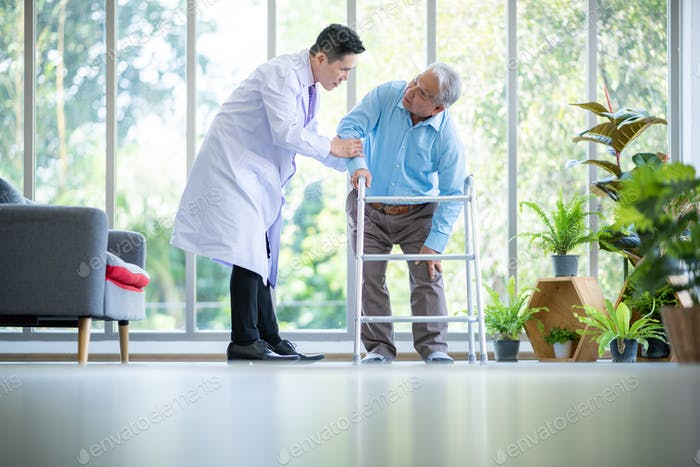 Orthopedic doctor and senior patient with walker at nursing home