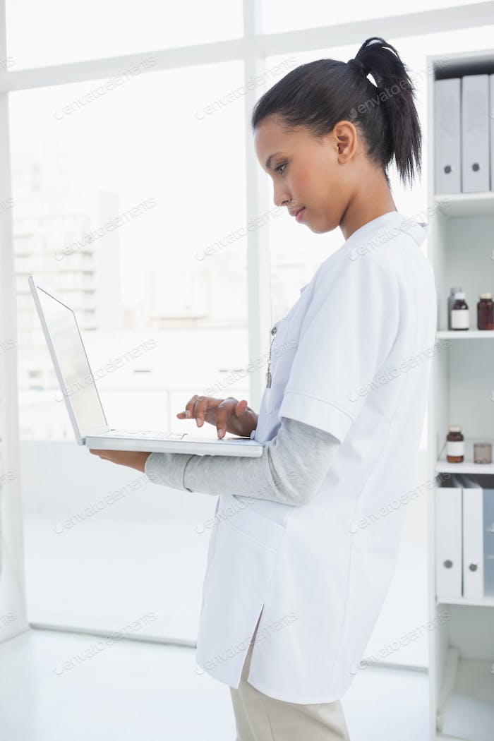 Doctor using her laptop in her office