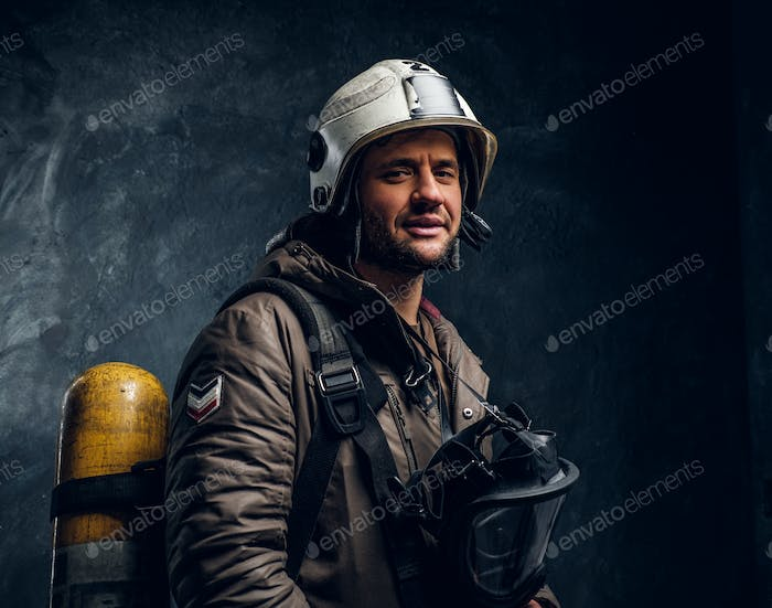 Smiling fireman with helmet and oxygen mask