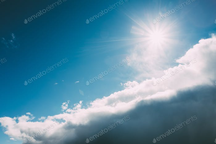 Dramatic Sky, Blue And White Colors. Sun Shine Over Fluffy Cloud