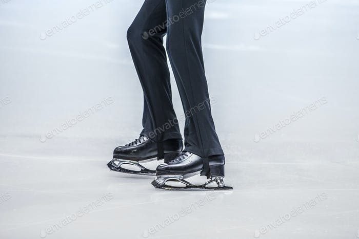 feet of a young athlete figure skater