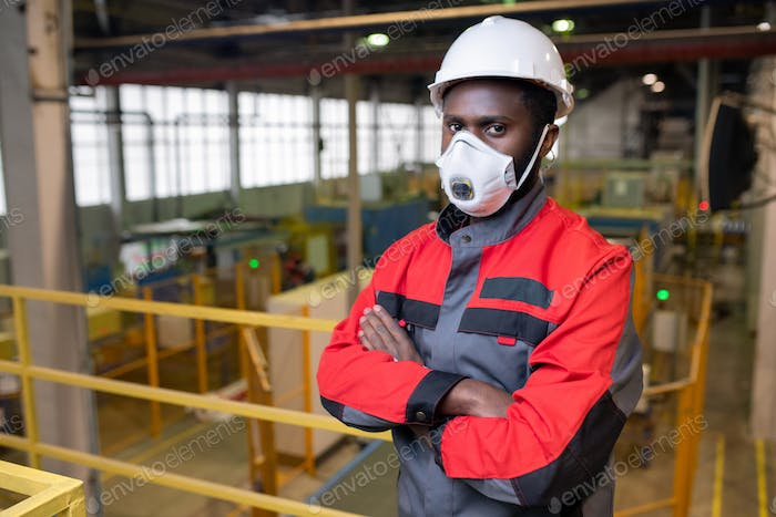 Young man working at toxic industry
