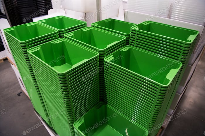 Many folding green boxes containers at store