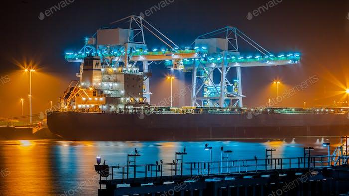 Transport Ship in harbor at night