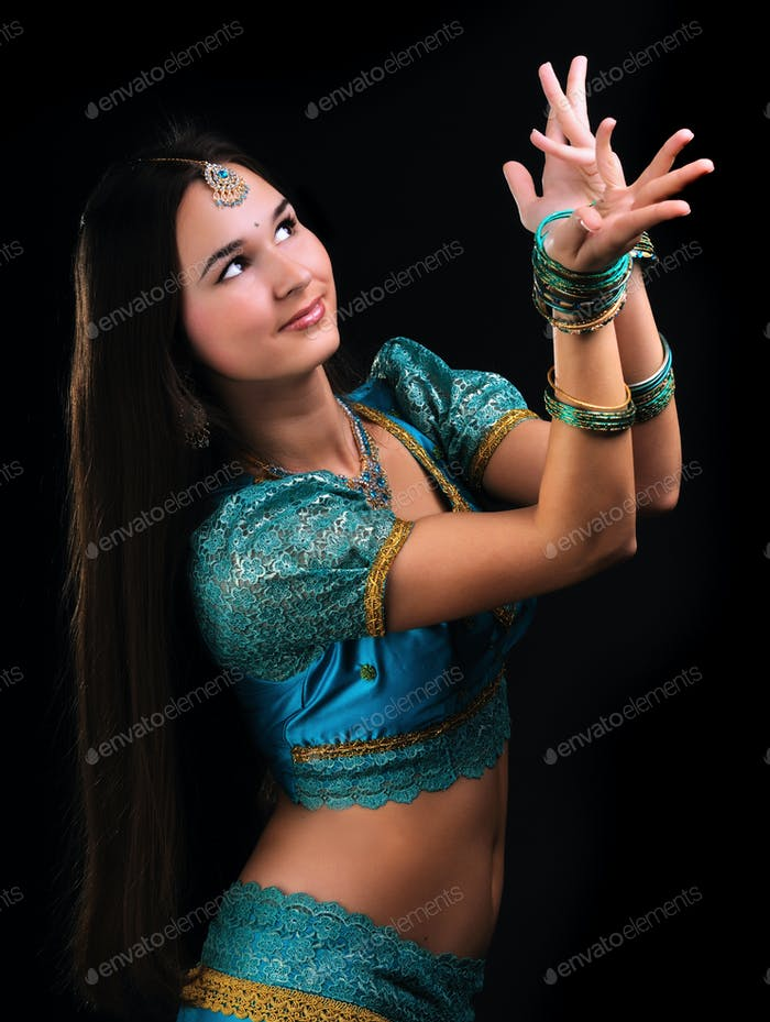 Female hands in movement of national indian dance