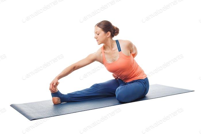 Woman doing Hatha yoga asana Ardha baddha padma paschimottanasan