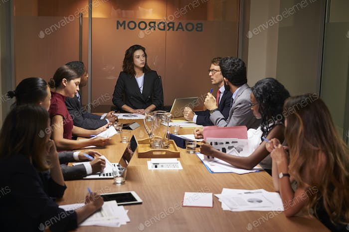 Female boss chairing a business meeting in a boardroom