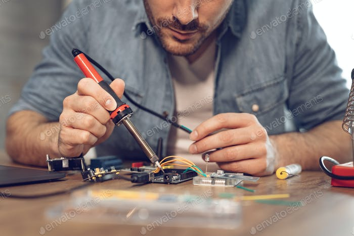 Engineer Working On Circuit Board