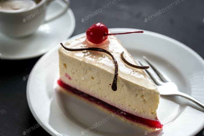 Raspberry cheesecake with sweet cherry