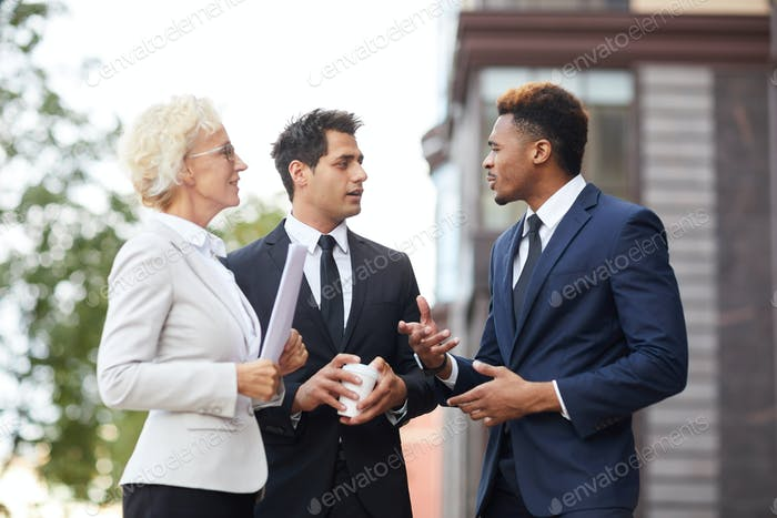 Confident African businessman explaining his opinion to colleagues