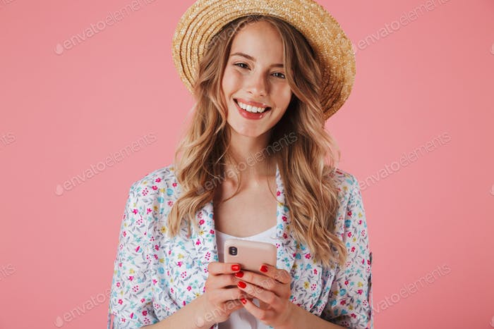 Portrait of a happy young woman in summer dress
