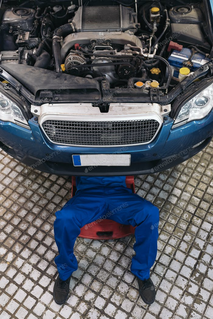 Professional Mechanic Repairing Car.