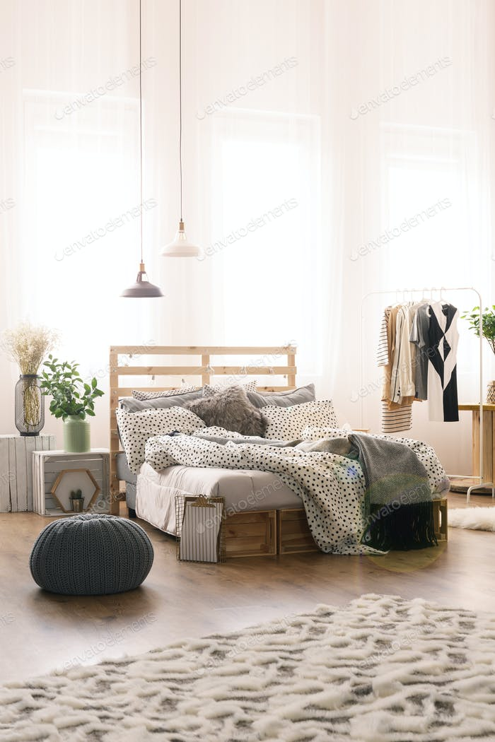 Spacious bedroom with carpet