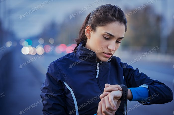 Jogger checking smart watch