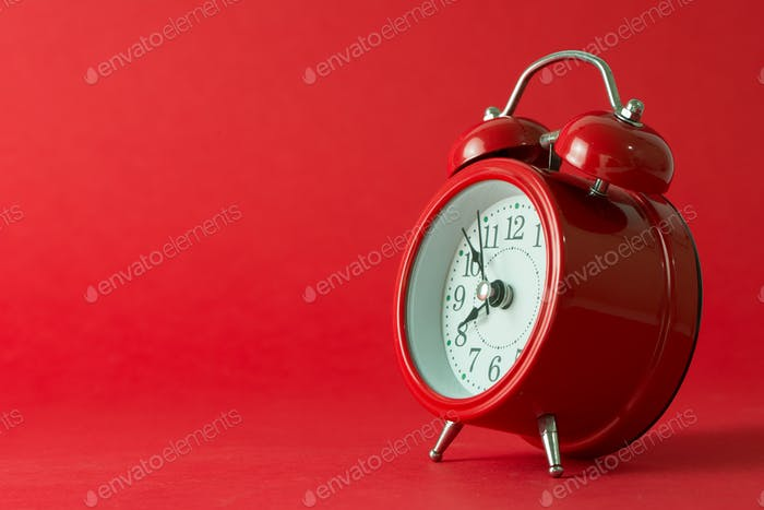 Red classic alarm clock isolated
