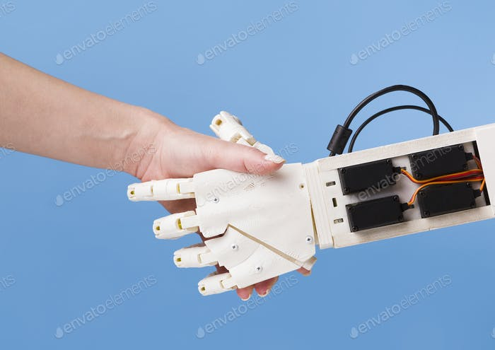 Robot and human handshake. Cooperation of people and technology